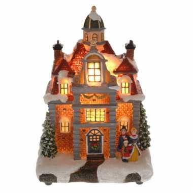 Kerstkerstdorp huisje met gezin met verlichting | Kerstdorp-kopen.nl