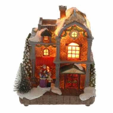 Kerstkerstdorp huisje met vrouw en kind met verlichting | Kerstdorp ...