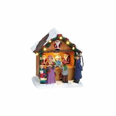 Verlichte kerstkerstdorp huisjes kerstman kraam