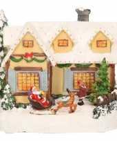 Kerstdorp geel kerstkerstdorp huisje met kerstman 19 cm