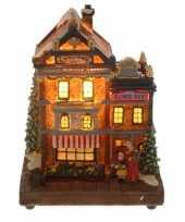 Kerstkerstdorp huisje bloemenwinkel met verlichting